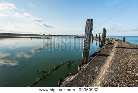 Old Breakwater In A Small Harbor