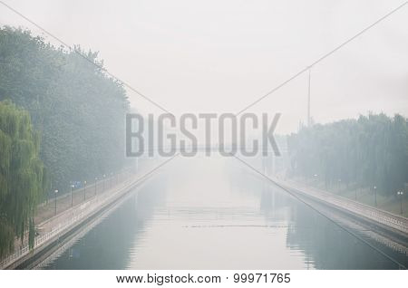 Beijing Air Pollution Seen From A Bridge Overlooking A Canal