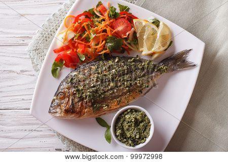 Grilled Dorado Fish With Pesto And Salad Closeup. Horizonta Top View