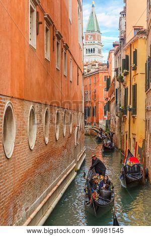 Gondolas on lateral narrow canal in Venice, Italy