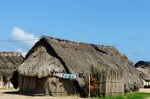 Panama Traditional house Kuna indians with the roof thatched on a islands on the San Blas archipelag poster