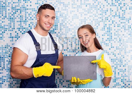 Attractive cleaners are cleaning a house with fun
