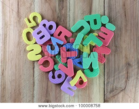 The Numbers And Letters Arranged In A Shape Heart.