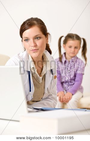 Female Doctor Write Prescription For Child