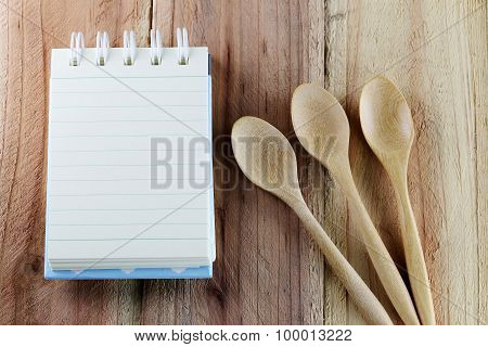 Notebook And Wooden Spoon.