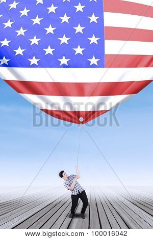 Caucasian Person Pulling Down American Flag