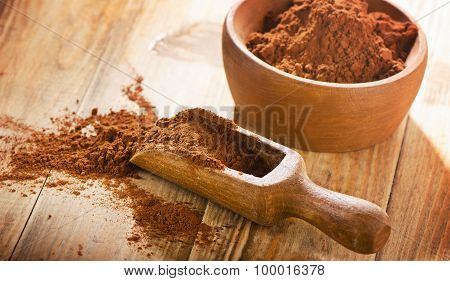 Cacao Powder In  Wooden Scoop.