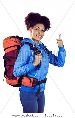 Young woman with backpack hitchhiking against a white background