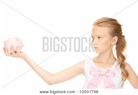 Lovely Teenage Girl With Piggy Bank