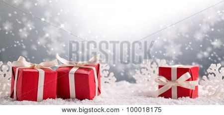 Christmas gift boxes on snow