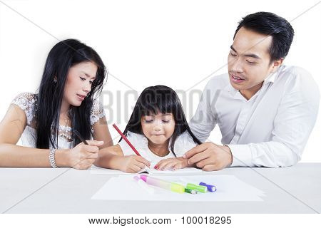 Hispanic Parents Help Their Daughter Studying