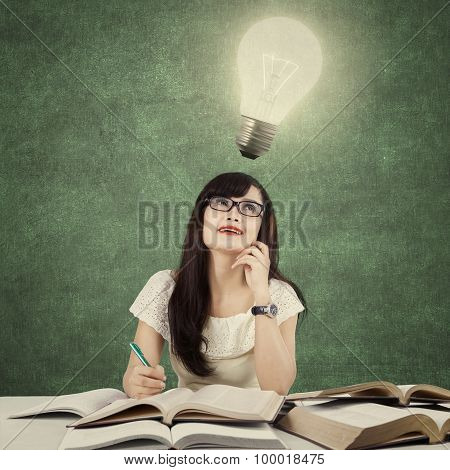 Learner Getting Idea And Look At Light Bulb