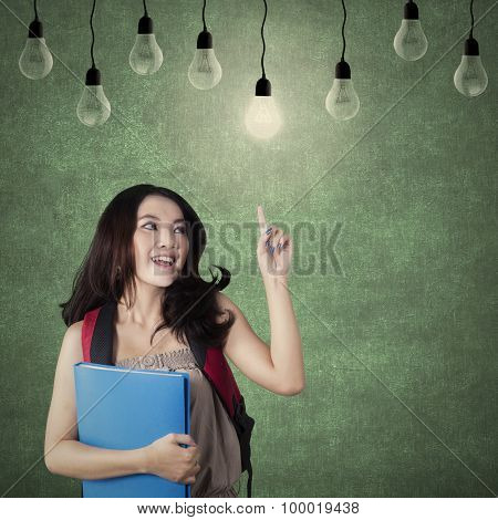 Smart Student Choosing A Bright Light Bulb