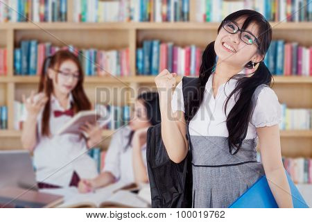 Successful Student With Her Group In Library