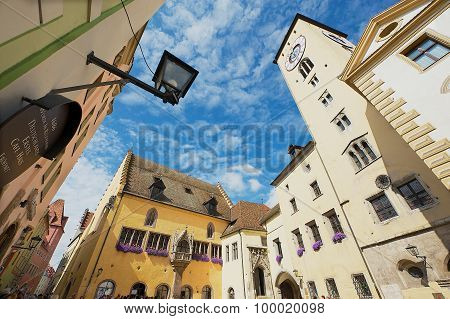 Exterior of the tower and the historical town hall with the blue sky above in Regensburg, Germany.