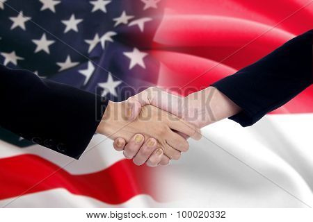 Workers Handshake With The American And Indonesian Flags
