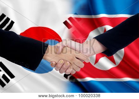 Workers Handshake With Two Korean Flags