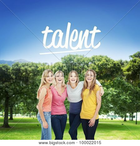 The word talent and smiling girls holding each other as they stand beside one another against park