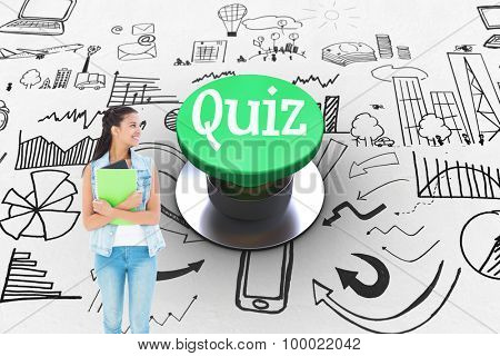 The word quiz and student holding notepads against digitally generated green push button