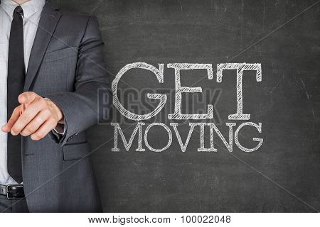 Get moving on blackboard with businessman