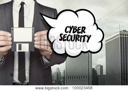 cyber security text on speech bubble with businessman holding diskette