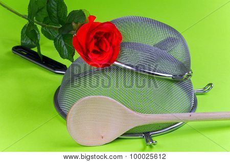 Kitchen Sieve With Red Rose Wooden Spoon
