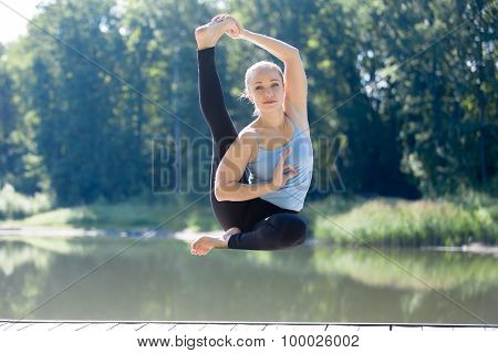 Yogi Female Sitting In Yoga Asana In Mid Air