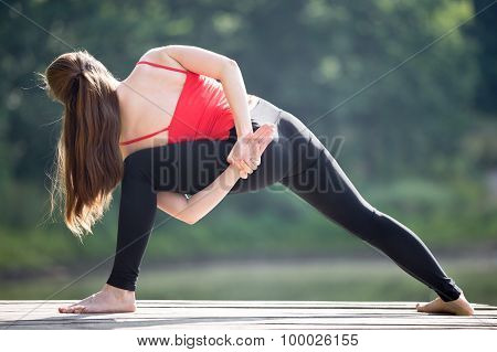 Teenage Girl Doing Revolved Side Angle Pose