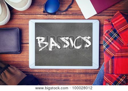 The word basics and differents objects using every days against black wall