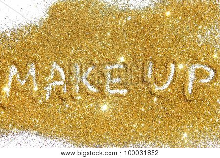 Inscription Make Up on gold glitter sparkle on white background