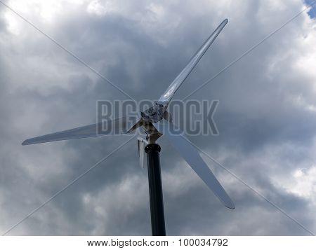 Wind turbine on a background cloudy sky