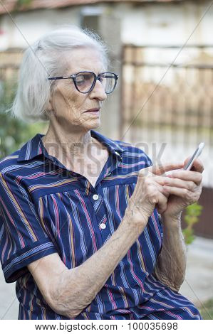 Grandma Trying To Use Modern Smartphone Outdoors