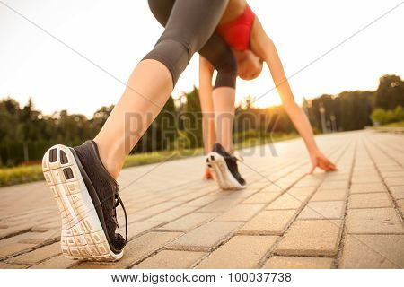 Cute young sport girl is preparing for jogging