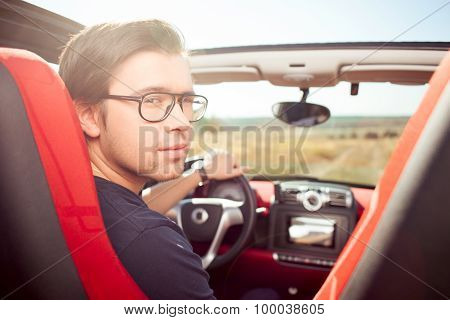 Handsome young guy is traveling by personal transport