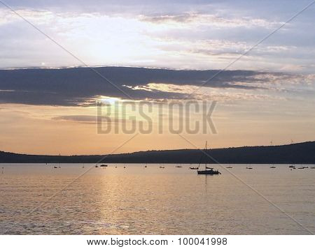 Boats moored under the setting sun