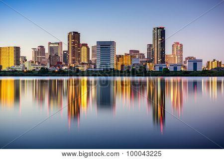 Osaka, Japan skyline at the Umeda District on the Yodogawa River.