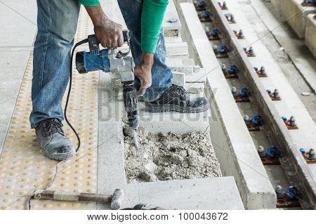 Worker Breaking Concrete