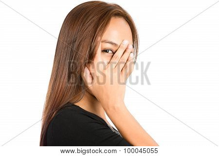 Portrait Asian Woman Peeking Out Through Fingers