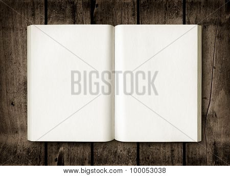 Open Book On A Dark Wood Table