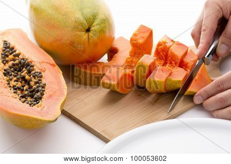 Cutting A Papaya Quarter Into Six Slices