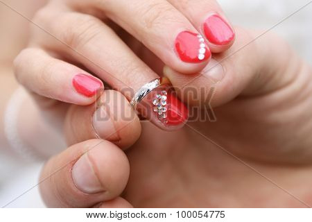 Putting A Ring On Finger Of Bride