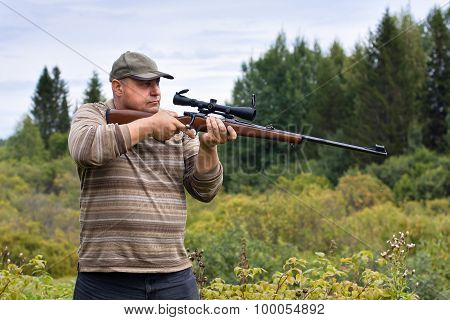 Hunter Aiming From A Rifle
