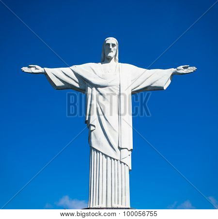 RIO DE JANEIRO, BRAZIL - APRIL 24, 2015: Statue of Christ the Redeemer stands in clear blue sky in bright morning sun on April 24, 2015, Rio de Janeiro, Brazil.