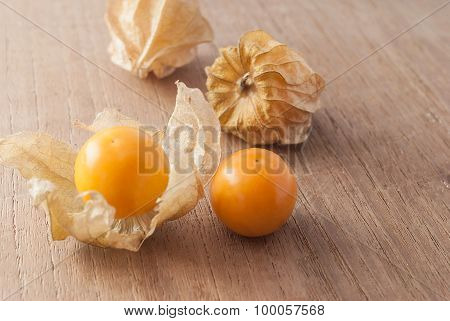 Cape gooseberry (Physalis) on wooden table, healthy fruit and vegetable