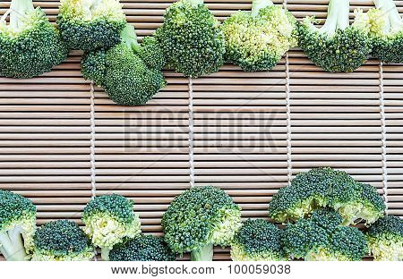 Row Of Fresh Broccoli On Pattern Bamboo For Background