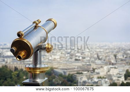 Tourist coin operated telescope looking out over a city view