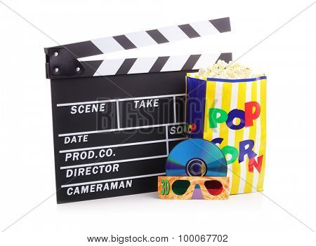 Movie clapper board, box of popcorn and a DVD disc with 3d glasses