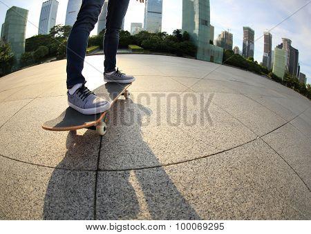 young skateboarder legs  skateboarding at sunrise city