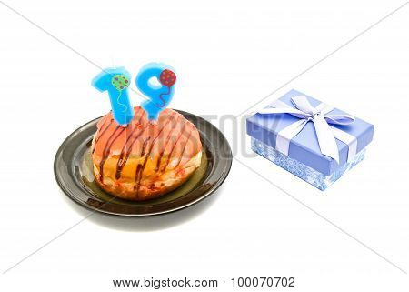Donut With Nineteen Years Birthday Candle And Gift