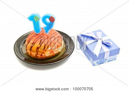 Donut With Nineteen Years Birthday Candle And Gift On White